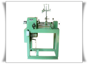 FRICTION DRIVEN TRANSFORMER WINDING MACHINE